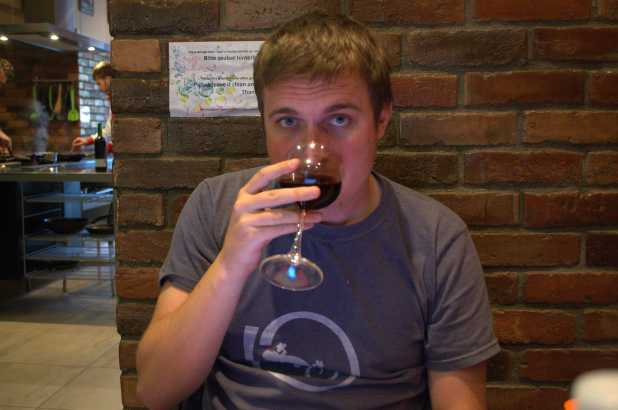 Lee enjoying some red wine in a hostel in Vienna, Austria
